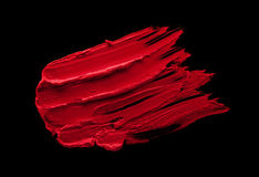 Red lipstick smudge. D on a black isolated background Stock Photos