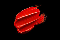 Red lipstick smudge. D on a black isolated background Stock Photo