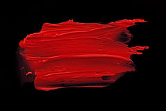 Red lipstick smudge. D on a black isolated background Royalty Free Stock Photo