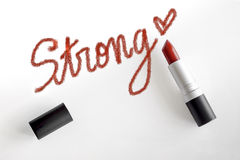 Red Lipstick with strong word and heart handwriting stroke Royalty Free Stock Photography
