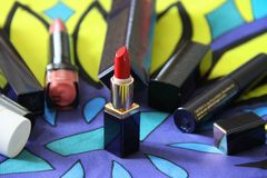 Red lipstick and tools. Bright cosmetic set and tools royalty free stock image