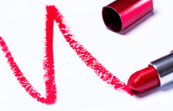 Red lipstick with trace. Over white background Stock Images