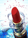 Red lipstick in water splash Royalty Free Stock Photography