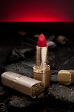 Red lipstick with water spray Stock Photos