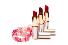 Red lipstick and womens jewelry Stock Image
