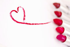 Red lipsticks & heart mark, focus on heart Stock Photos