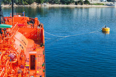 Red Liquefied Petroleum Gas tanker in port. Red Liquefied Petroleum Gas tanker does mooring operations in Port of Ajaccio, Corsica, France Stock Image