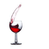 Red liqueur glass. alcohol drink splashing. copy space, white background Royalty Free Stock Image
