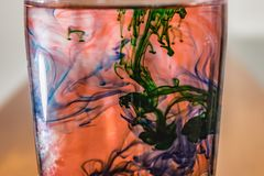 Red liquid with green and blue. Dye added stock photos