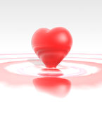 Red liquid heart Stock Images