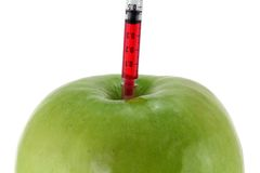 Red Liquid injecting to a Green Apple Stock Photos