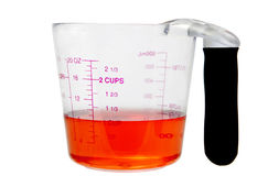 Red liquid in measuring cup Royalty Free Stock Image