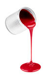 Red liquid paints spouting from can isolated Stock Images