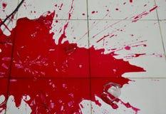 Red liquid splash on tile floor. Red liquid splash on the tile floor stock photo