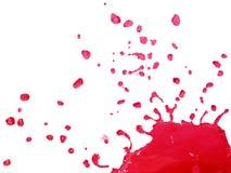 Red Liquid Splashing and Falling Stock Photo