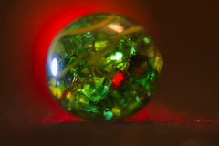 Red lit Green glass marble 20. Red lit Green glass marble abstract texture background royalty free stock photography