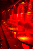 Red lit Lounge. Line of tables and booth with red lighting Royalty Free Stock Images