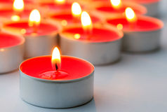 Red lit tea lights Royalty Free Stock Images