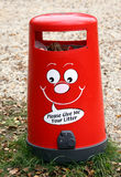 Red litter bin. Close up of red litter bin standing in the park Royalty Free Stock Image