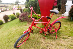 Red little bike. For child at the yard Stock Photography