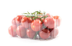 Red, little, cherry tomatoes on a plastic container on a white background Stock Photography