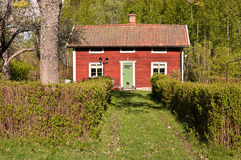 A red little cottage. Royalty Free Stock Image
