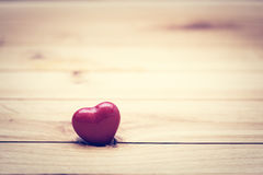 Red little heart on wood. Vintage concept of love, Valentine's Day Stock Image