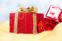 Red little shiny presents and gift boxes Stock Images