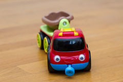 Red Little toy car with a trailer Royalty Free Stock Photography