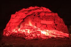 Red live coals in the hearth furnace Stock Photos