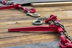 Red Load Chain Binder. Bright red chain load binder on a truck deck royalty free stock image