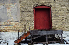 Red Loading Door. A red loading door with stairway in an old brick tobacco building in Edgerton, Wisconsin royalty free stock images