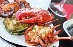 Red lobster with artichoke. Stock Image