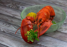 Red lobster in bowl on wooden background Royalty Free Stock Images