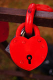 Red lock as heart. Red heart-shaped lock on the bridge Stock Image