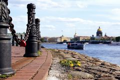 The red lock on the chain. The Neva embankment. Boats on the river stock photo