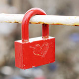 Red lock with hand drawn heart symbol Royalty Free Stock Photos