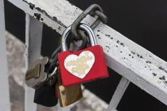 Red lock with heart. Wedding symbol. stock photos