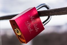 Love lock. Red lock with the love message in German on it Stock Photos