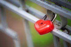 Red lock in shape of heart Stock Photo