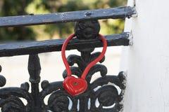 Red Locks in heart shape wedding bridge photo.  Love concept. Stock Photography