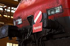 Red locomotive. In a repair workshop Royalty Free Stock Photo