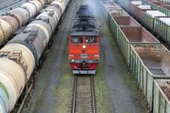 Red locomotive approaching. stock photography