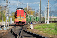 Red locomotive and Green freight cars Royalty Free Stock Photography