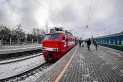Red locomotive on train station platform in the winter Stock Images