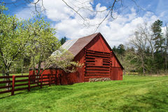 Red Log Barn and Apple Orchard Royalty Free Stock Photography