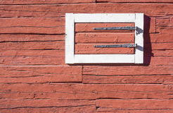 Red Log House Wall with Hatch Stock Image