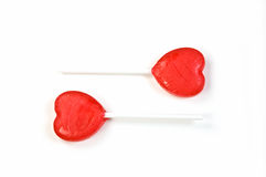 Red lollipop hearts. On white background for Valentine's Day Royalty Free Stock Image