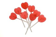Red lollipop hearts Stock Photos