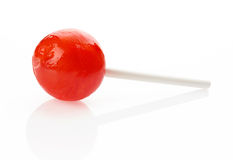 Red lollipop on white Stock Photo